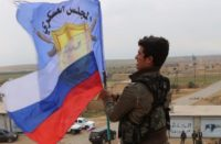 Russian flag hoisted in Syria's Manbij