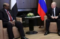 Russian President Vladimir Putin talks with Sudan's President Omar al-Bashir during their meeting in the Black Sea resort of Sochi, Russia, Nov. 23, 2017