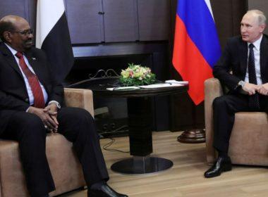 Russian President Vladimir Putin talks with Sudan's President Omar al-Bashir during their meeting in the Black Sea resort of Sochi, Russia, Nov. 23, 2017
