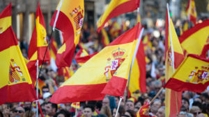 Protesters wave Spanish flags during a pro-unity demonstration on October 29, 2017 in Barcelona, Spain. Thousands of pro-unity protesters gather in Barcelona, two days after the Catalan Parliament voted to split from Spain. The Spanish government has responded by imposing direct rule and dissolving the Catalan parliament