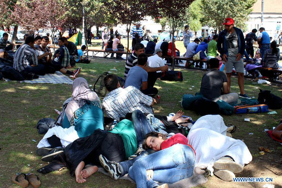 Migrants from Middle East and Africa camp in a park waiting to get transportation to Serbia's northern border with Hungary on their way to Germany, in Belgrade, Serbia, on Aug. 24, 2015.
