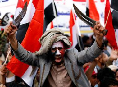 A man waves traditional daggers, or Jambiyas, as he attends with supporters of the Houthi movement and Yemen's former president Ali Abdullah Saleh a rally to mark two years of the military intervention by the Saudi-led coalition, in Sanaa, Yemen