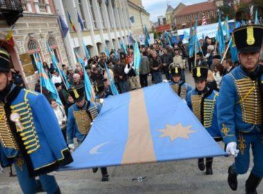 Members of Romania's Szekler minority march with their flag