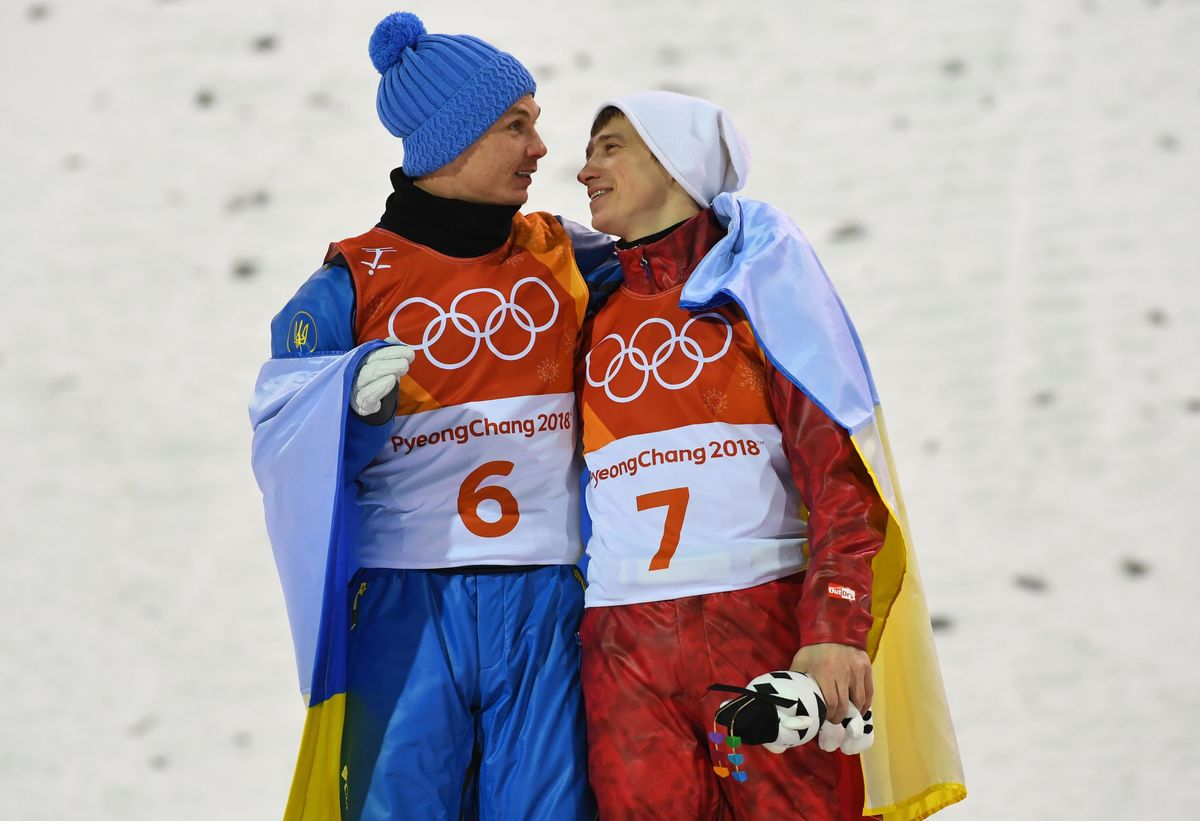Alexander Abramenko (Ukraine, №6) and Ilya Burov (Russia, №7) friendly embracing at the podium of PyeongChang Olympics freestyle skiing aerials competition after winning the gold and bronze medals respectively.
