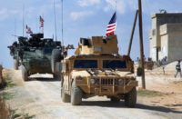 U.S. forces patrolling on the outskirts of the Syrian town of Manbij, in Aleppo province
