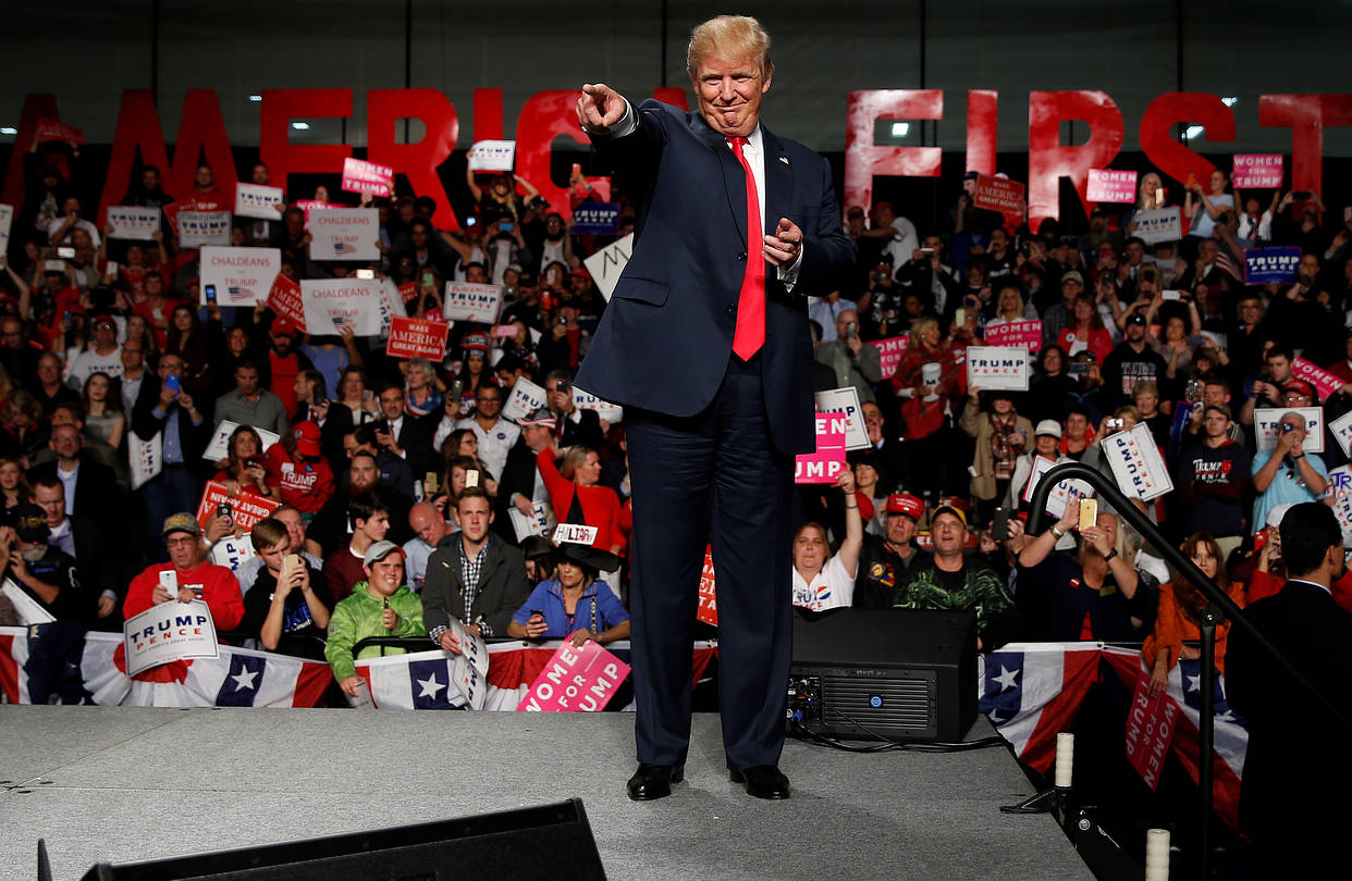 Donald Trump at a campaign rally featuring his 'America First' slogan