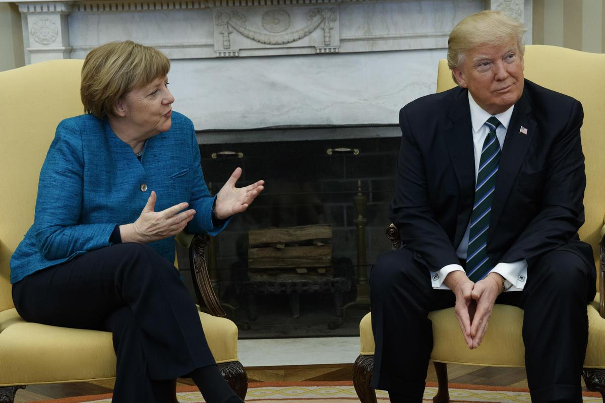 President Donald Trump meets with German Chancellor Angela Merkel in the Oval Office of the White House