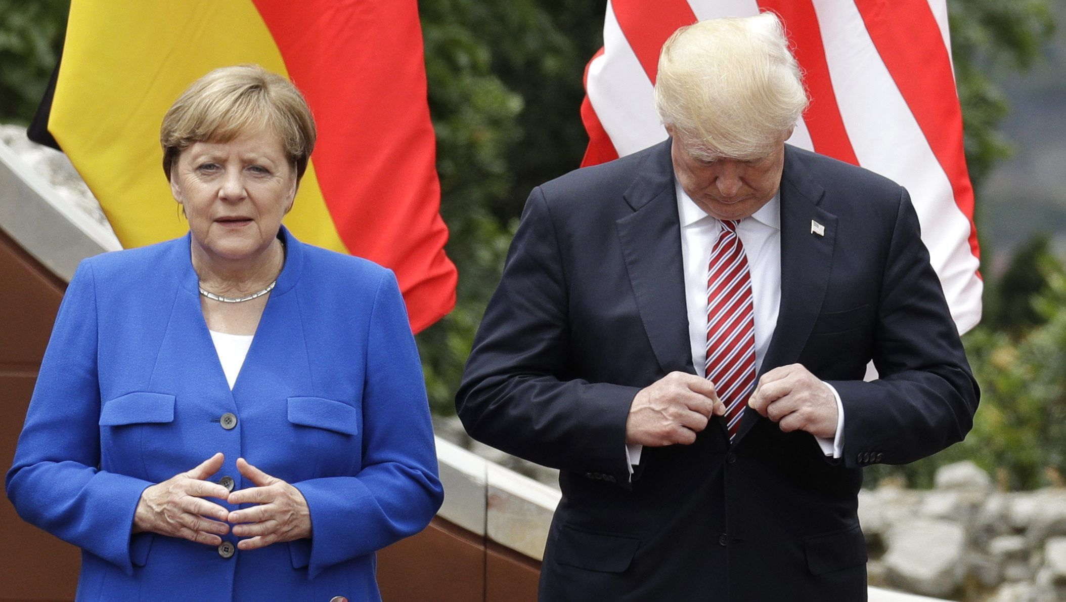 U.S. President Donald Trump, with German Chancellor Angela Merkel prior to a group photo