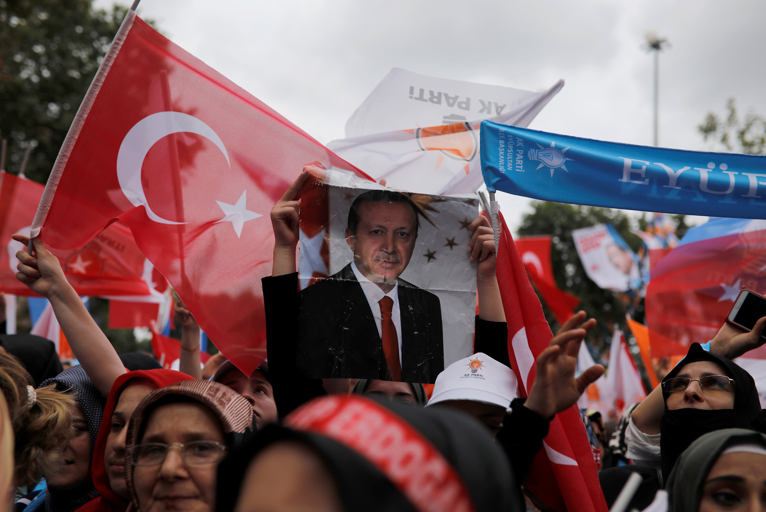Supporters of Turkish President Tayyip Erdogan attend his election rally in Istanbul