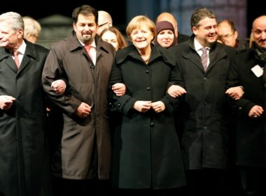 Merkel marched arm in arm with Aiman Mazyek