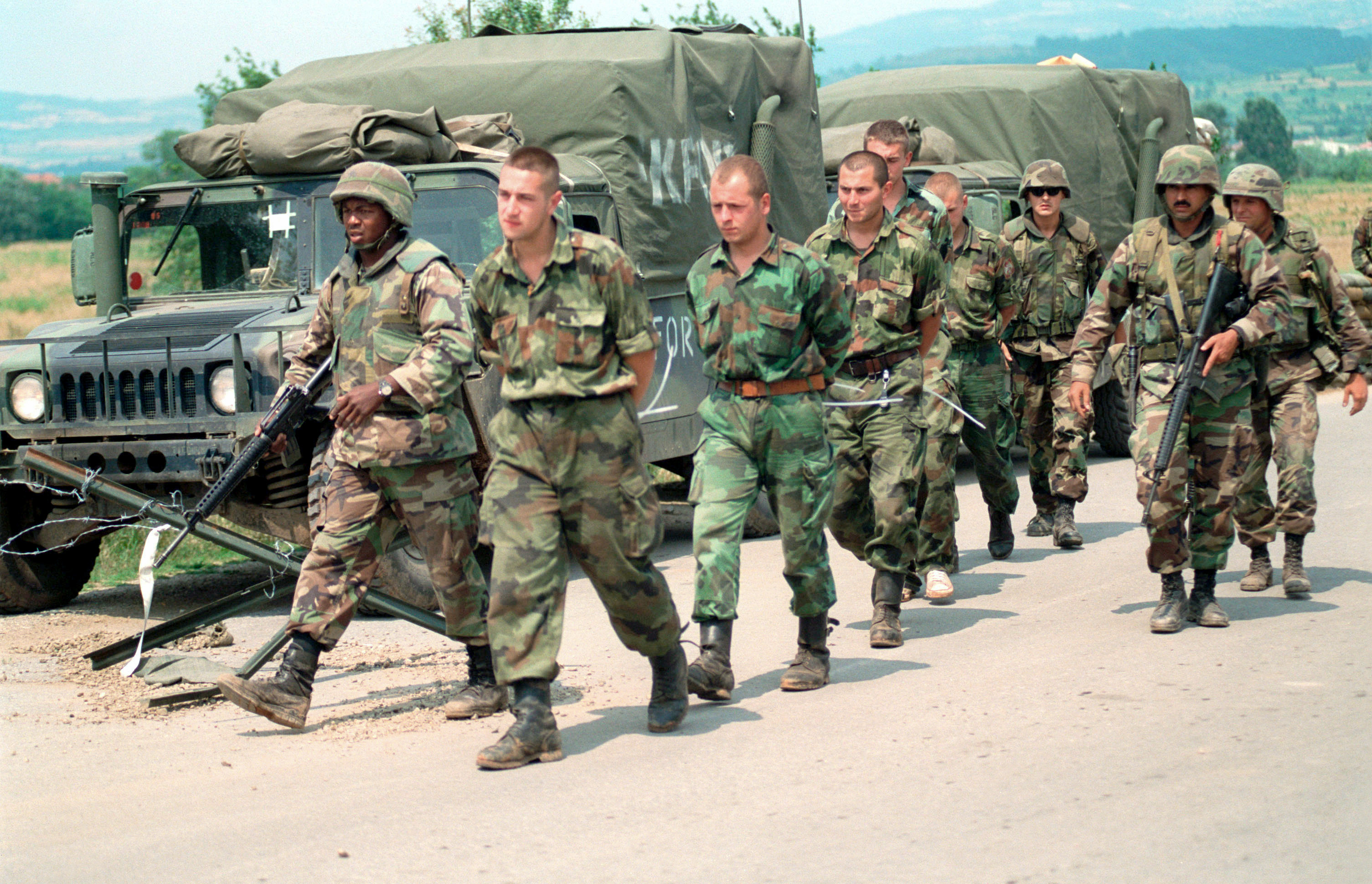 U.S. Marines escorting Yugoslavian POWs in Kosovo to be handed over to Yugoslavian authorities