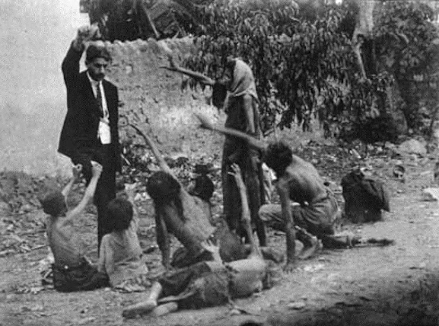 Turk official teasing Armenian starved children