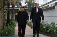 U.S. President Donald Trump and North Korea's leader Kim Jong Un walk in the garden at the Metropole hotel during the second North Korea-U.S. summit in Hanoi