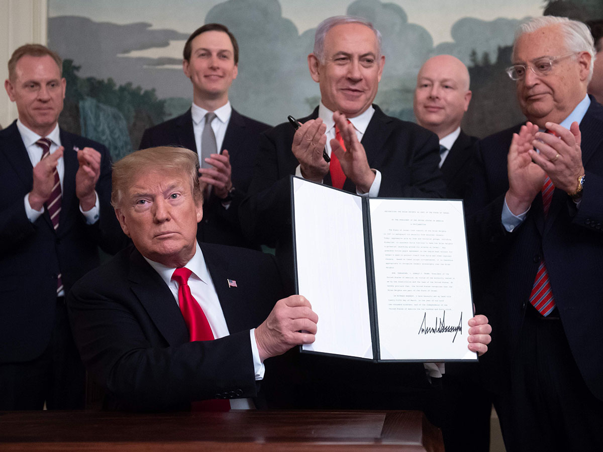US President Donald Trump holds up a signed Proclamation on the Golan Heights alongside Israeli Prime Minister Benjamin Netanyahu in the Diplomatic Reception Room at the White House in Washington, DC, March 25, 2019
