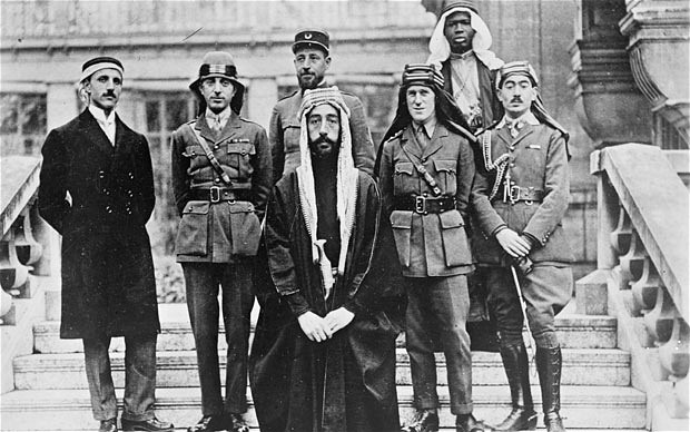 Faisal bin Hussein bin Ali al-Hashemi (centre) with delegates including Lawrence of Arabia (in headdress third from right) at Versailles during the 1919 Paris peace conference.