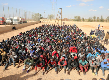 Migrants sit at a detention center in Gharyan