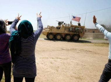 Kurds wave US troops