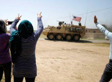 Kurds wave US troops