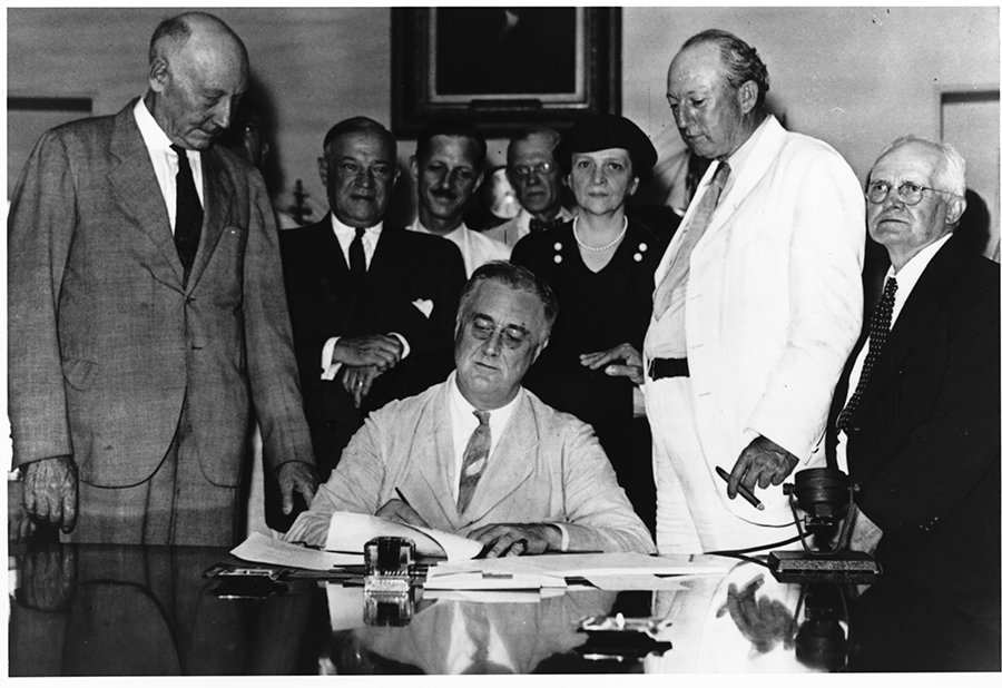 President Roosvelt signs a social security act