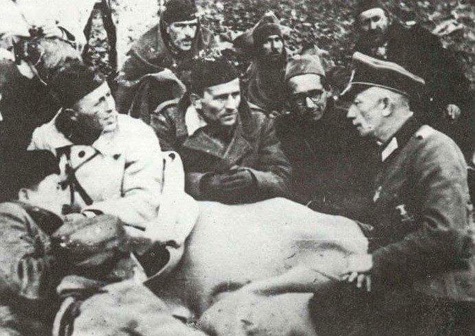 Partisans with German officer Artur Schtrecher