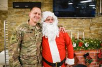 A soldier with a Santa