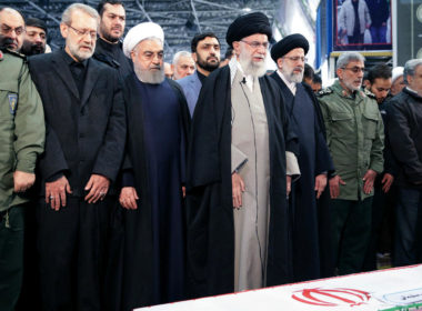 Khamenei before the coffin of Soleimani