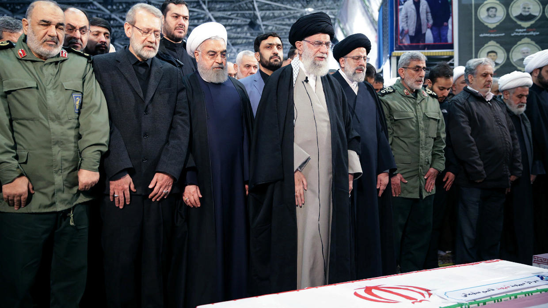 Khamenei before the coffin of Soleimani
