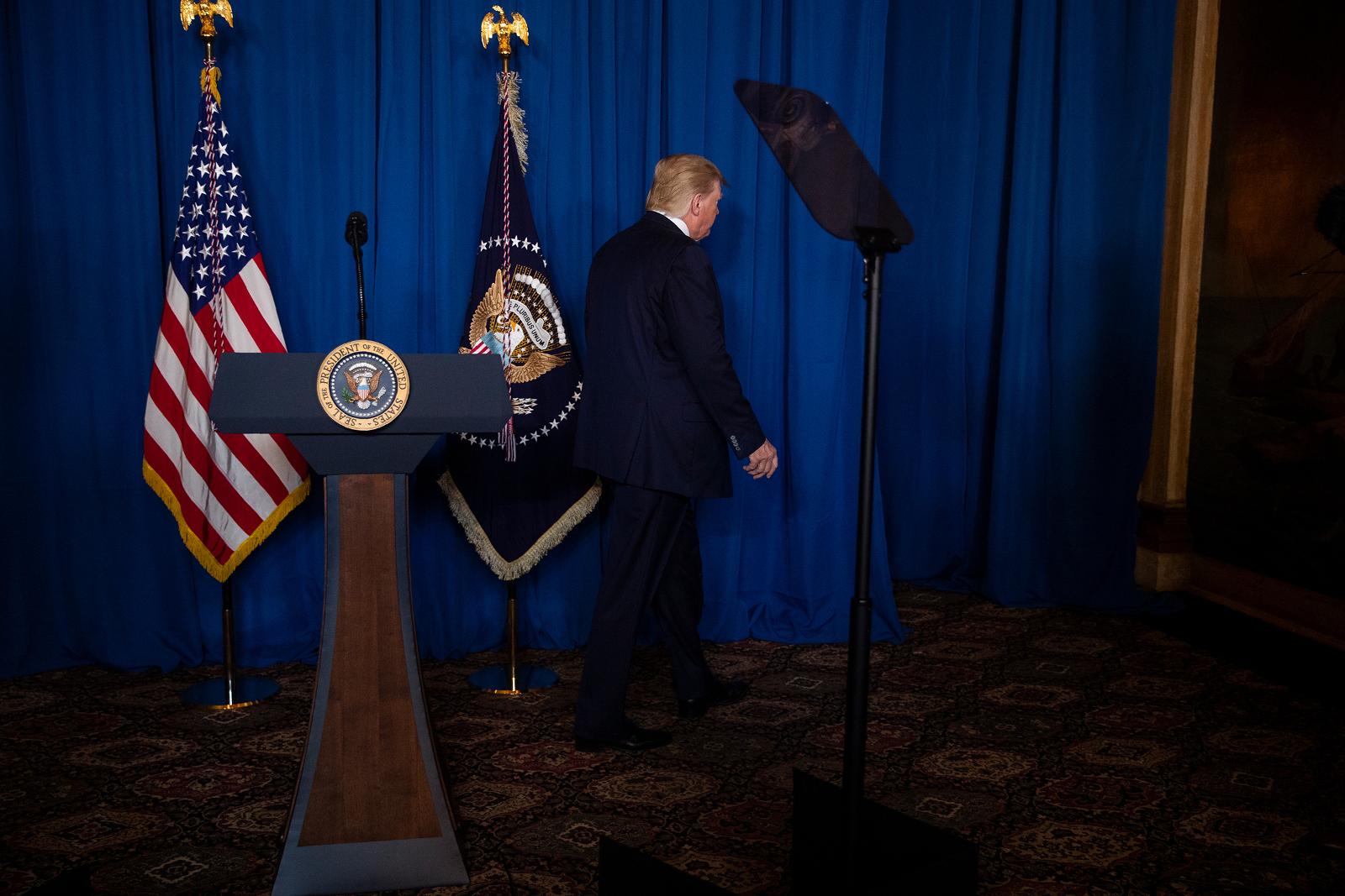 Trump walks off after delivering remarks on Iran