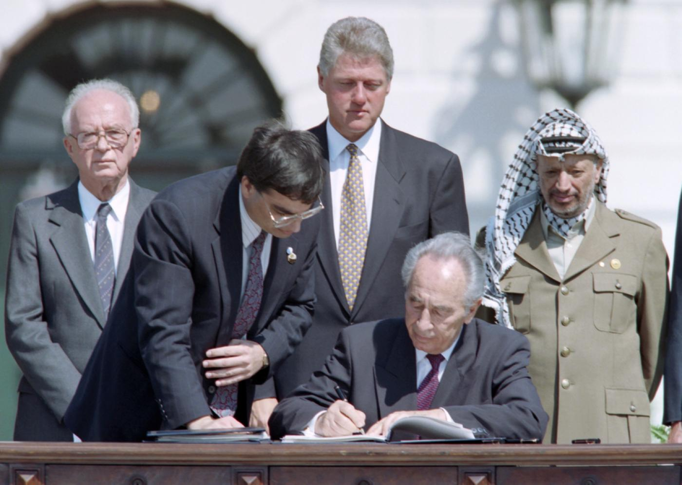 Israeli President Shimon Peres signs the Israel-PLO Oslo accords, 1993