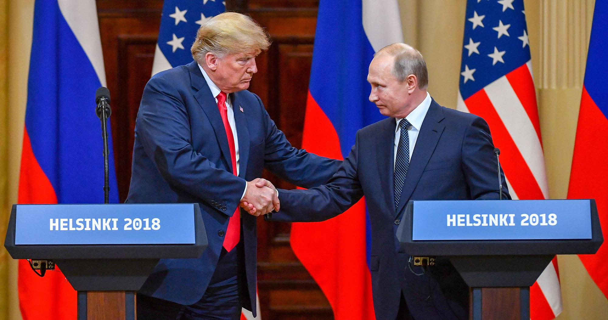 Trump and Putin shaking hands in Helsinki