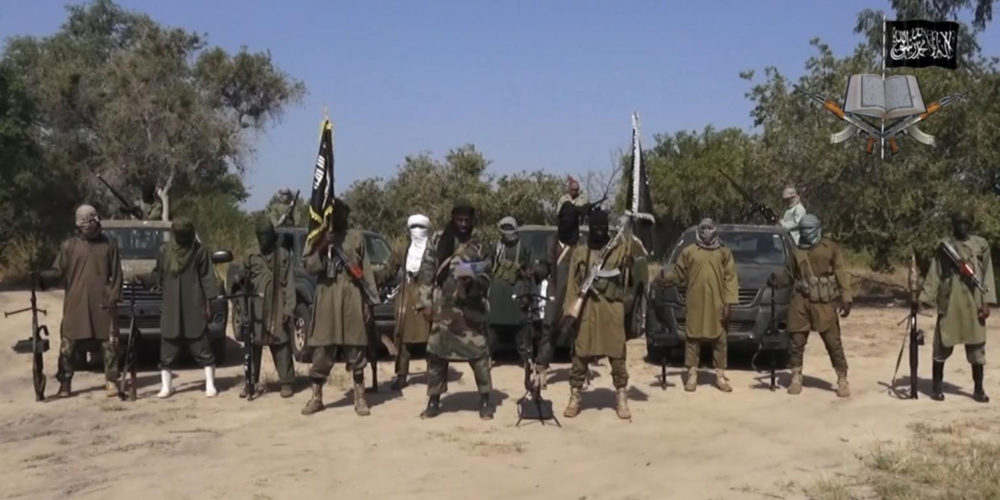 Abubakar Shekau stands at the centre of a Boko Haram video from 2014