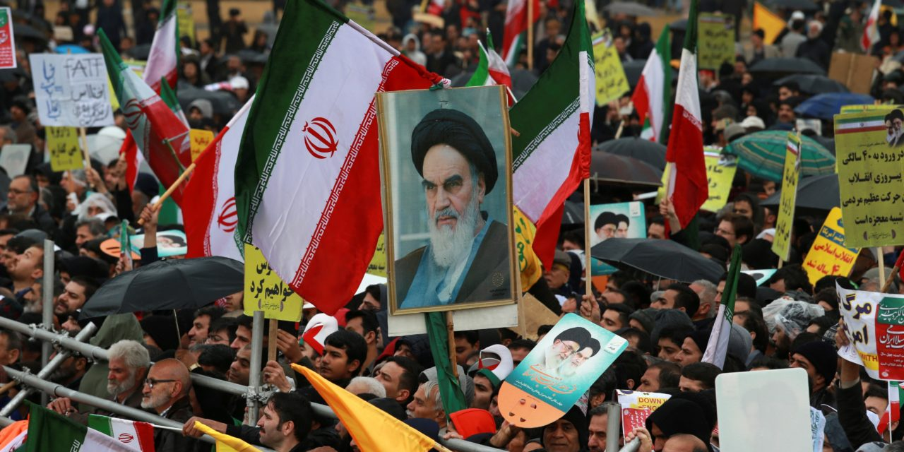 Iranians attend a ceremony